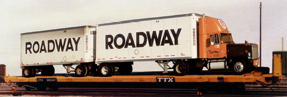 Roadway truck on train