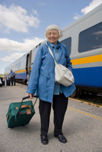 Elderly woman at passenger train platform